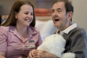 Regis Dandenong North - Resident and carer with PARO