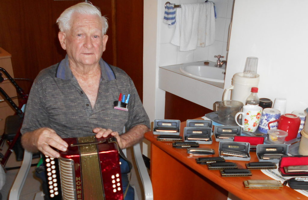 Bill Flynn with all of his harmonicas