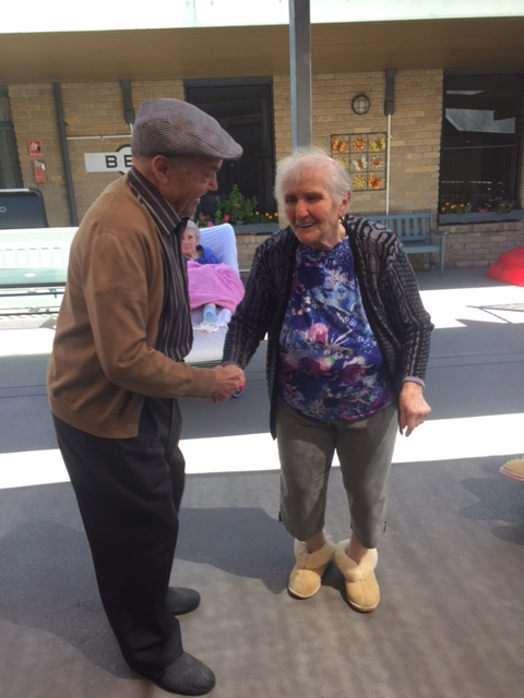 Aged care residents take time for a dance at Regis Ringwood