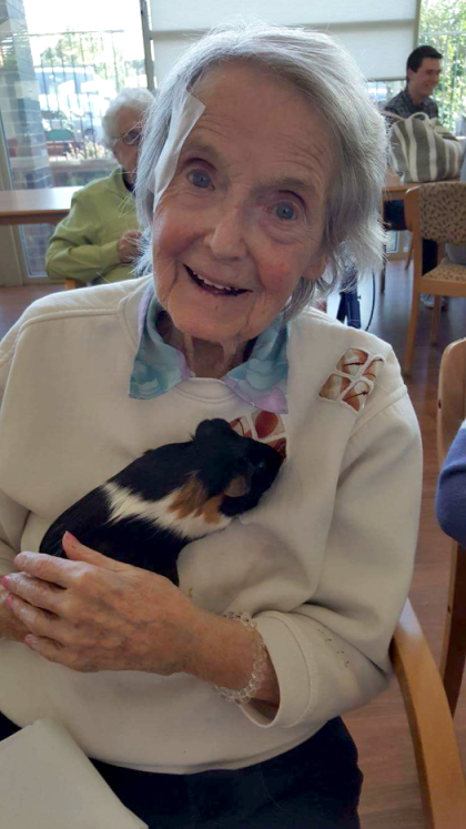 Pam holding a guinea pig from petting farm