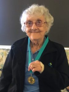 Cranbourne resident proudly shows gold medal