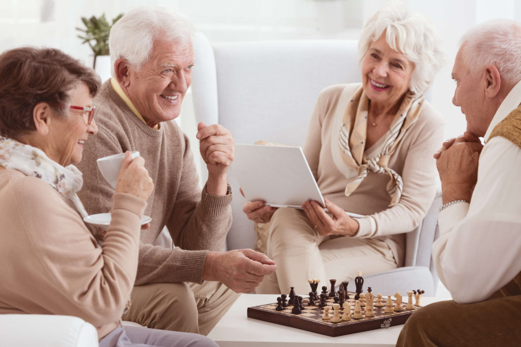 regis retirement villages gold coast - residents playing chess